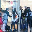 Carl (chauffeur et garde du corps), Jade et Joy, Laeticia Hallyday, Jimmy Reffas, Françoise Thibaut, la mère de Laeticia Hallyday - Laeticia Hallyday arrive en famille avec ses filles et sa mère à l'aéroport Roissy CDG le 19 novembre 2019.