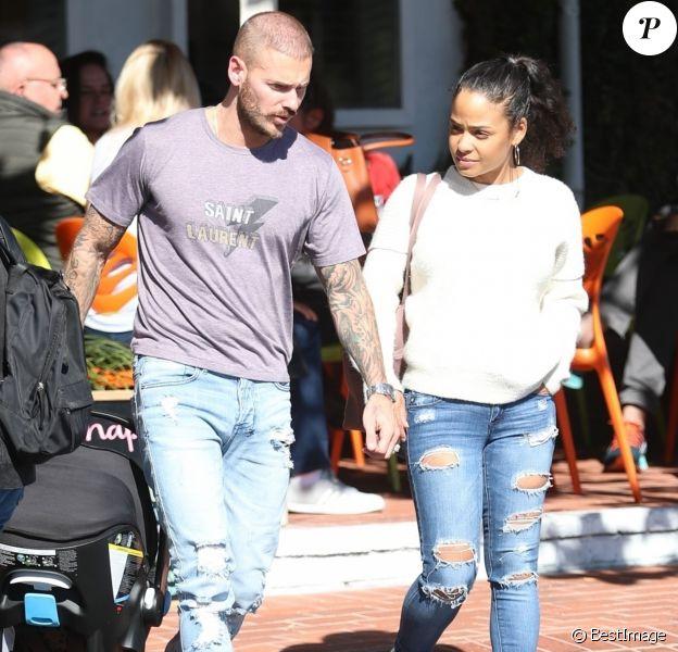 M. Pokora et sa compagne Christina Milian se baladent avec leur fils Isaiah dans le quartier de West Hollywood à Los Angeles. La petite famille est allée déjeuner chez Fred Segal. Le 11 février 2020