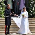 Le prince Harry et Meghan Markle à la sortie de chapelle St. George au château de Windsor - Sortie après la cérémonie de mariage du prince Harry et de Meghan Markle, le 19 mai 2018. Au fond, se trouvent Doria Ragland, le prince Charles et son épouse Camilla.