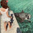 Arhur dévoile une photo de Manava à Tahiti, avec un dauphin, le 5 août 2020