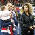 Layvin Kurzawa avec Mélissa Chovet et leur fille - Le PSG célèbre son titre de Champion de France 2019 au Parc ders Princes à Paris, le 18 mai 2019. © Marc Ausset-Lacroix/Bestimage