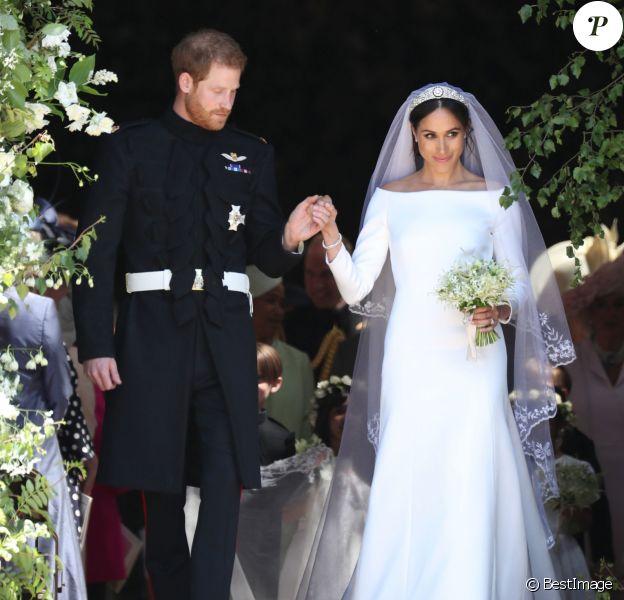 Le prince Harry et Meghan Markle (en robe de mariée Givenchy), duc et duchesse de Sussex, à la sortie de chapelle St. George au château de Windsor après leur mariage