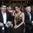 Cheryl Cole entourée de Simon Cowell et Louis Walsh