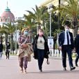 """Christian Estrosi, maire de Nice, et son épouse Laura Tenoudji assistent au vernissage de l'exposition """"Libres et Égales"""" de la photographe Sylvia Galmot, sur la Promenade des Anglais. Nice, le 8 mars 2021. © Bruno Bebert / Bestimage"""