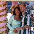 """Christina Milian, enceinte, et M Pokora (Matt) font la promotion de la marque """"Beignet Box"""" de Christina sur un char lors d'une parade à Los Angeles le 10 avril 2021."""