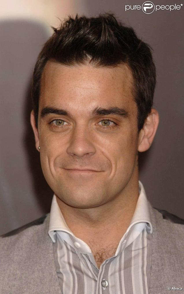309708-robbie-williams-a-bien-change-il-se-637x0-1