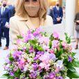 La Première dame Brigitte Macron lors de la traditionnelle cérémonie du muguet du 1er Mai au palais de l'Elysée à Paris, France, le 1er 2021. © Jacques Witt/Pool/Bestimage
