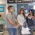 Robbie Williams avec Ayda Field, aéroport de Miami, le 18 juin 2009.