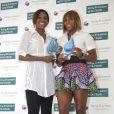 Venus et sa soeur Serena Williams lors de la remise des récompenses de la WTA à Miami le 24 mars