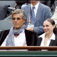Dominique Desseigne et la Alexandra Cardinale lors de la cinquième journée du tournoi des internationaux de tennis de Roland Garros 2010 le 27 mai 2010