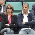 Sabri Lamouchi et une amie lors de la cinquième journée du tournoi des internationaux de tennis de Roland Garros 2010 le 27 mai 2010