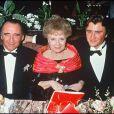 Claude et Alexandre Brasseur entourant Odette Joyeux en 1992
