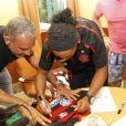 Christian Audigier rencontre le footballeur Ronaldinho à Rio, au Brésil, début février 2011