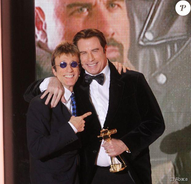Robin Gibb et John Travolta lors des Golden Camera Awards à Berlin le 5 février 2011