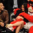John Legend et sa chérie Christine Teigen à la soirée des NBA All-Star Game, à Los Angeles le 20 février 2011