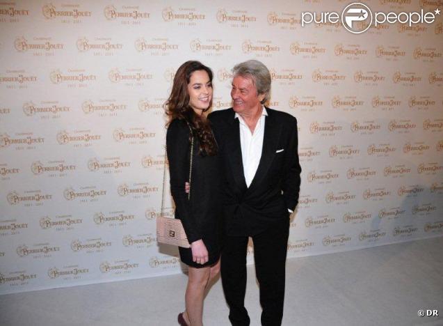 Anouchka et Alain Delon au bicentenaire de la Maison Perrier-Jouët, à Paris, le 21 mars 2011.