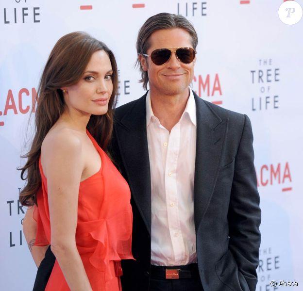 Angelina Jolie et Brad Pitt à l'occasion de l'avant-première hollywoodienne de The Tree of Life, dans l'enceinte du Bing Theatre de Los Angeles, le 24 mai 2011.