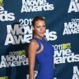 Blake Lively dans une robe sexy signée Michael Kors a fait sensation sur le tapis rouge pour les MTV Movie Awards