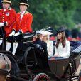 La princesse Catherine Middleton, la duchesse de Cornouailles Camilla Parker Bowles et le prince Harry lors du Trooping the colour, célébration de l'anniversaire de la reine Elizabeth II,  le 11 juin 2011 à Londres