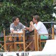 Michael Ballack sur une terrasse à Miami avec un ami le 27 mai 2011
