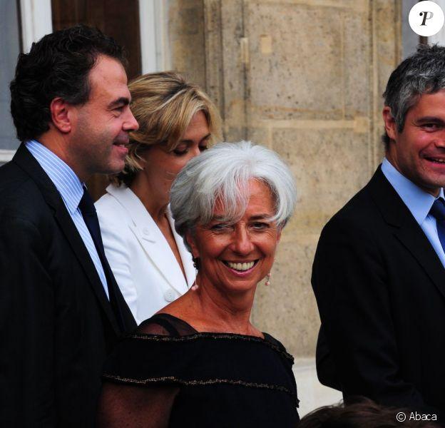 Pour son dernier conseil des ministres, Christine Lagarde a encore éblouit avec une robe voilée noire. Paris, 29 juin 2011