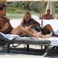 Shauna Sand et son mari Laurent à la plage à Miami, le 14 juillet 2011