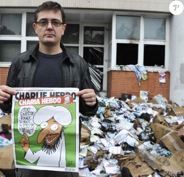 La directeur de la publication Charb devant les locaux incendiés de Charlie Hebdo, le 2 novembre 2011.