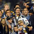 David Beckham et ses trois fils, Brooklyn, Romeo et Cruz le 20 novembre 2011 au Home Depot Center de Carson à Los Angeles après sa victoire en finale du championnat des États-Unis