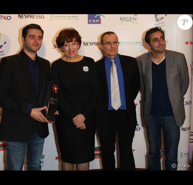 Roselyne Bachelot auprès d'Eric Toledano et Olivier Nakache lors de la cérémonie des Trophées APAJH au Carrousel du Louvre à Paris le lundi 5 décembre 2011