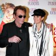 Johnny et Laeticia Hallyday à l'avant-première des  Tribulations d'une caissière , à Paris, le 12 décembre 2011.