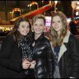 Natalie Bader, directrice générale de Prada France, et ses filles à l'inauguration de Jours de fêtes au Grand Palais, à Paris, le 15 décembre 2011.