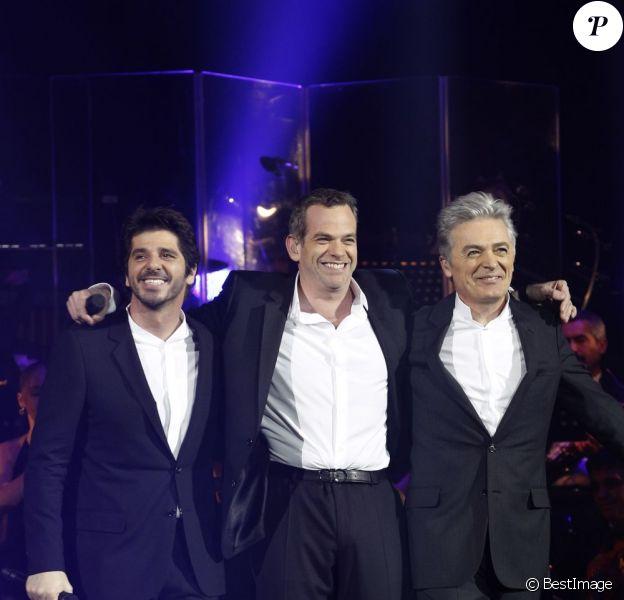 Patrick Fiori, Garou et Daniel Lavoie sur la scène de Bercy, le dimanche 18 décembre 2011.