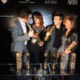 Michel Hazanavicius, Bérénice Bejo et Thomas Langmann lors de la soirée The Artist au restaurant Le Georges à Paris le 6 mars 2012