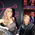 David et Cathy Guetta très complices lors du lancement de la Renault Twizy à l'Atelier Renault sur les Champs-Elysées à Paris le 27 mars 2012