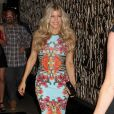 Fergie rayonnante dans une robe Givenchy se rend à sa soirée anniversaire à Las Vegas, le 31 mars 2012.