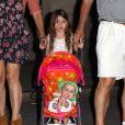 Exclusif : Suri Cruise, ravie de promener un vrai bébé avec sa maman Katie Holmes, ses grands-parents et des amis à Baton Rouge, à la Nouvelle Orléans le 31 mars 2012.