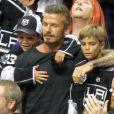 David Beckham et ses fils Cruz et Romeo pendant la finale de la Stanley Cup au Staples Center de Los Angeles, le 11 juin 2012.