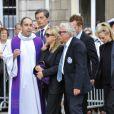 Jacques Vendroux, Françoise Boulain et son fils Gary lors des obsèques de Thierry Roland le 21 juin 2012 en l'église Sainte-Clotilde à Paris
