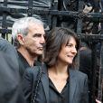 Estelle Denis et Raymond Domenech lors des obsèques de Thierry Roland le 21 juin 2012 en l'église Sainte-Clotilde à Paris