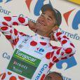 Thomas Voeckler triomphant après avoir décroché sa première victoire d'étape sur le Tour de France le 11 juillet 2012 entre Mâcon et Bellegarde-sur-Valserine