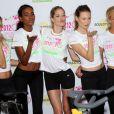 Les tops de Victoria's Secret Lindsay Ellingson, Arlenis Sosa, Doutzen Kroes, Behati Prinsloo, Erin Heatherton lors d'un événement sportif à New York le 11 juillet 2012