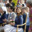 La princesse Madeleine et le prince Carl Philip de Suède.   La princesse Victoria de Suède a fêté dans la joie et l'allégresse son 35e anniversaire le 14 juillet 2012, assistant comme chaque année dans la soirée au festival de Borgholm, sur l'île d'Öland, en habit traditionnel et en compagnie de sa famille - le prince Daniel, le roi Carl XVI Gustaf, la reine Silvia, le prince Carl Philip et la princesse Madeleine.