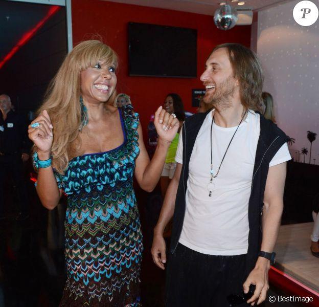 Cathy et David Guetta inaugurent le F*** Me I'm Famous Lounge Club au coeur de l'aéroport d'Ibiza, le 17 juillet 2012.
