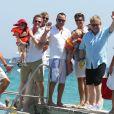 Neil Patrick Harris, son compagnon David Burkta et leurs jumeaux Gideon Scott et Harper Grace arrivent au Club 55 à Saint-Tropez le 2 août 2012