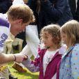 Les princes William et Harry disputaient le 5 août 2012 un match de polo caritatif au profit de trois associations qu'ils soutiennent, lors du Jerudong Trophy, dans les Costwolds.