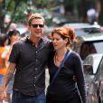 Debra Messing et son compagnon Will Chase dans les rues de New York, le 19 août 2012.
