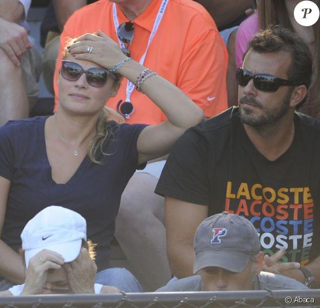 Melanie Maudran et son compagnon Thierry Ascione lors du match de la Française Kristina Mladenovic le 29 août 2012 à l'US Open à New York