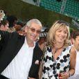 Michel Lacoste et son épouse Réjane lors du 75e anniversaire de la marque au crocodile à Roland-Garros. Paris, juin 2008.