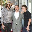 Ashton Kutcher, Jon Cryer, et Angus T. Jones à Los Angeles le 19 septembre 2011.