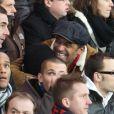 Yannick Noah et son fils Joalukas heureux lors du match entre le PSG et Evian Thonon Gaillard au Parc des Princes à Paris le 8 décembre 2012 à Paris (victoire du PSG 4-0)